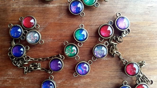 Handmade glass cabochon charms that resembles miniature galaxy